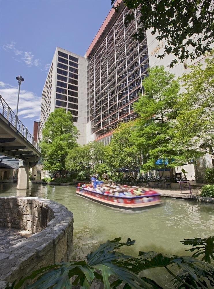 tree water Canal River waterway City walkway water feature dock flower tours