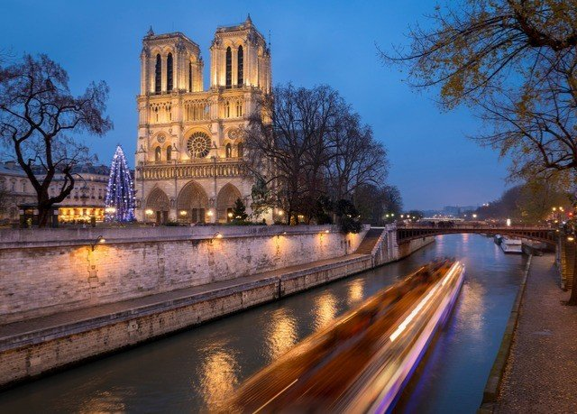 water sky building tree River Canal landmark waterway night Town City evening cityscape reflecting pool plaza cathedral dusk
