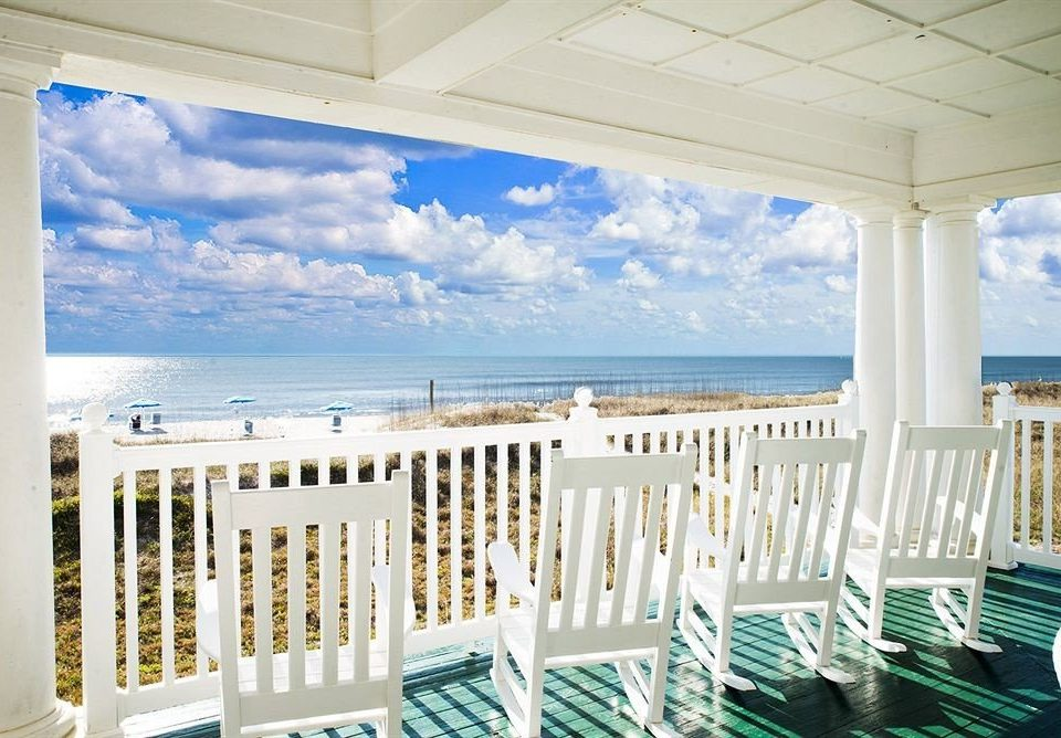 chair property white home condominium porch swimming pool caribbean overlooking