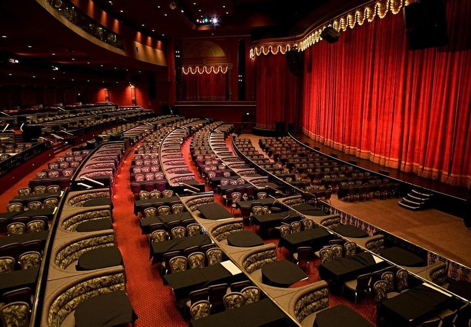 Casino Resort auditorium audience building stage movie theater performing arts theatre red long conference hall convention screenshot academic conference musical theatre hall
