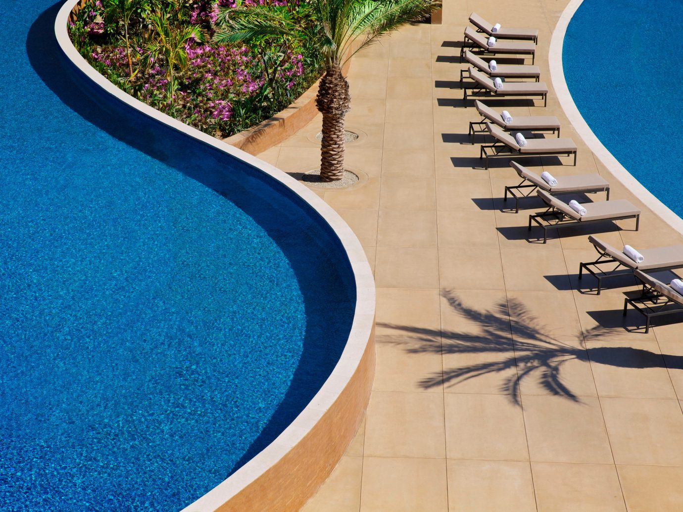 Budget Hotels blue swimming pool floor flooring walkway