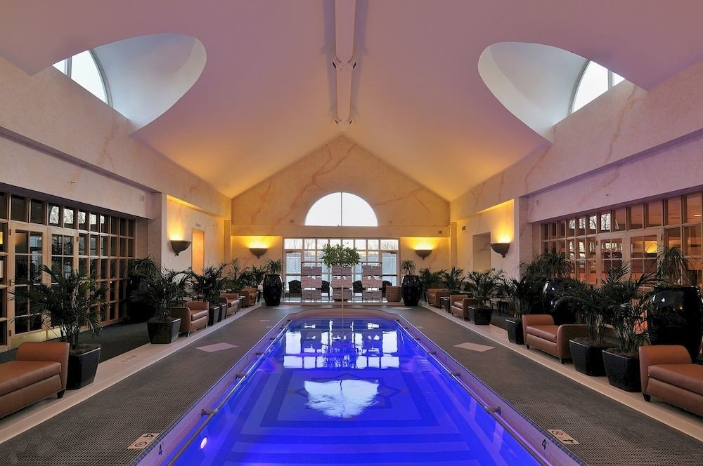 Health + Wellness Spa Retreats Trip Ideas billiard room Resort swimming pool Lobby estate ceiling function hall recreation room interior design convention center