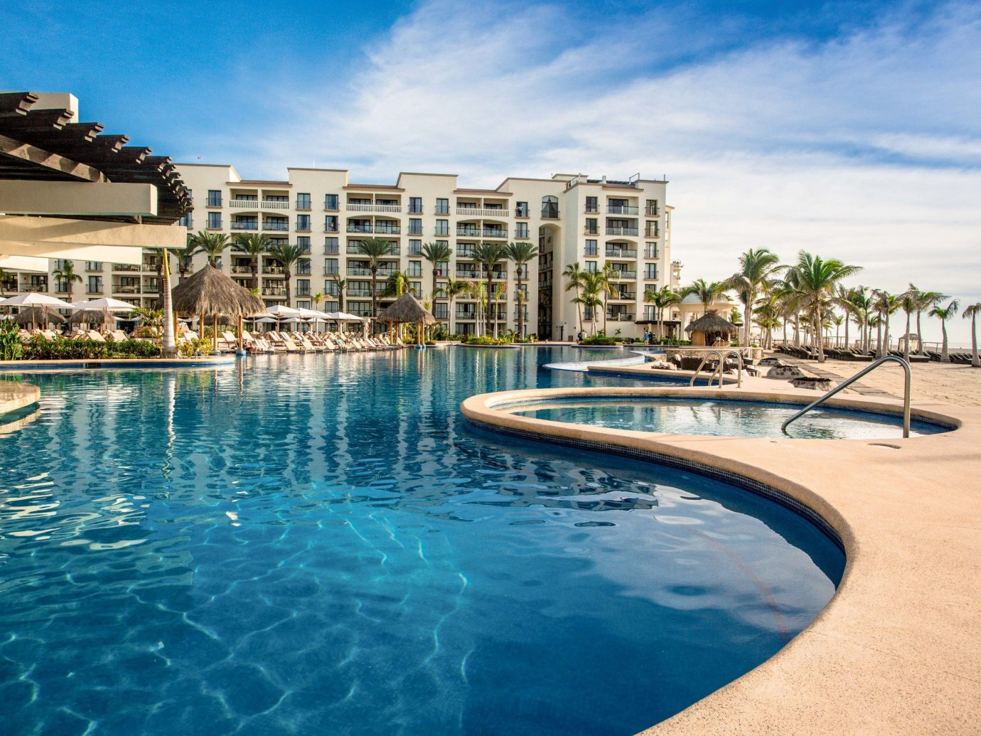 Hotels sky outdoor water swimming pool property leisure Resort condominium estate vacation Pool marina real estate dock bay Sea swimming shore day