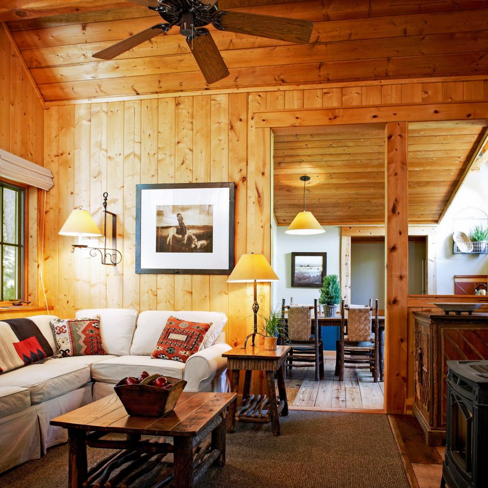 Celebs Hotels Trip Ideas living room chair home house beam log cabin