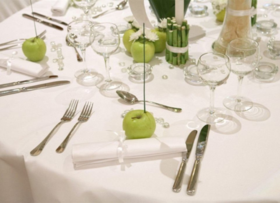 wine glasses centrepiece green tablecloth glass material dining table