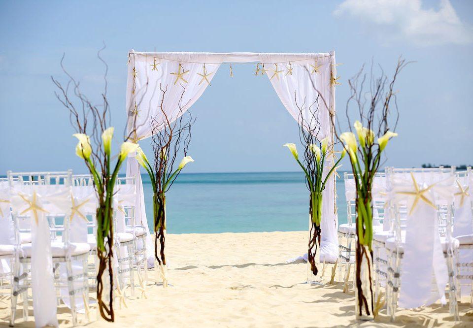 sky wedding ceremony shore