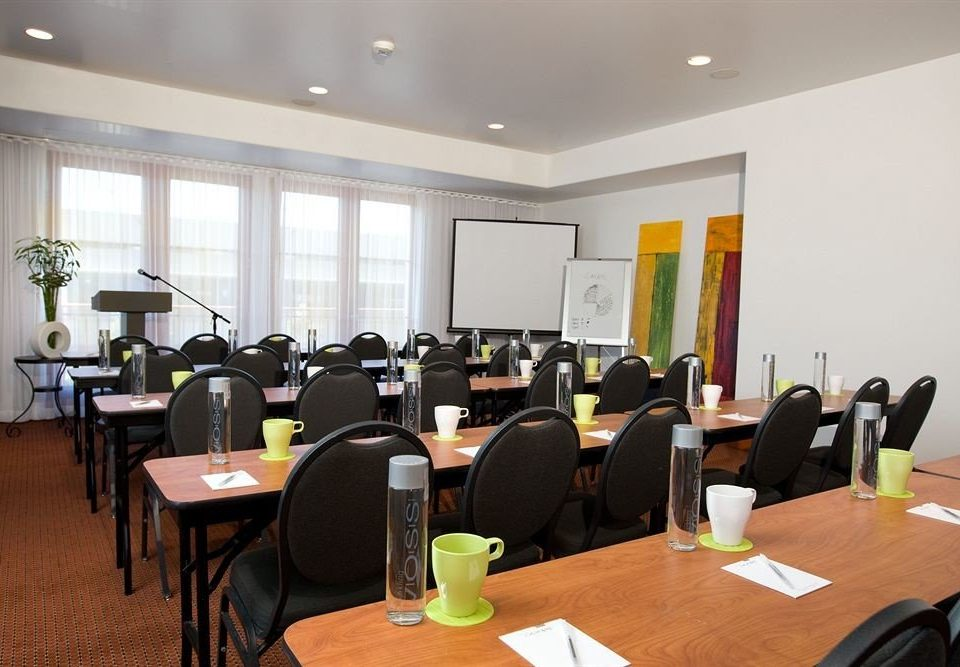 chair conference hall seminar meeting function hall conference room cluttered