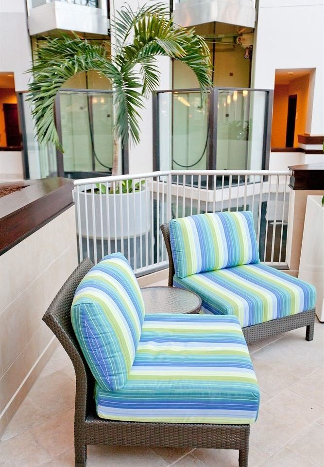 color living room chair property home green porch studio couch couch cottage
