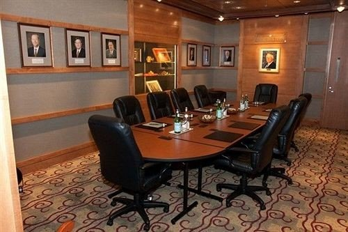 chair property recreation room conference hall living room conference room leather dining table