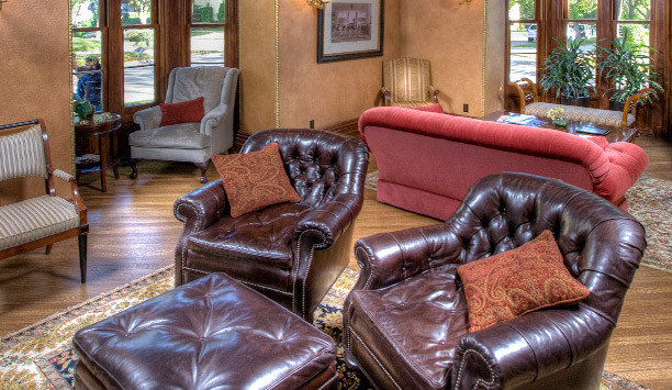 sofa leather seat property living room chair couch home house flooring loveseat hardwood