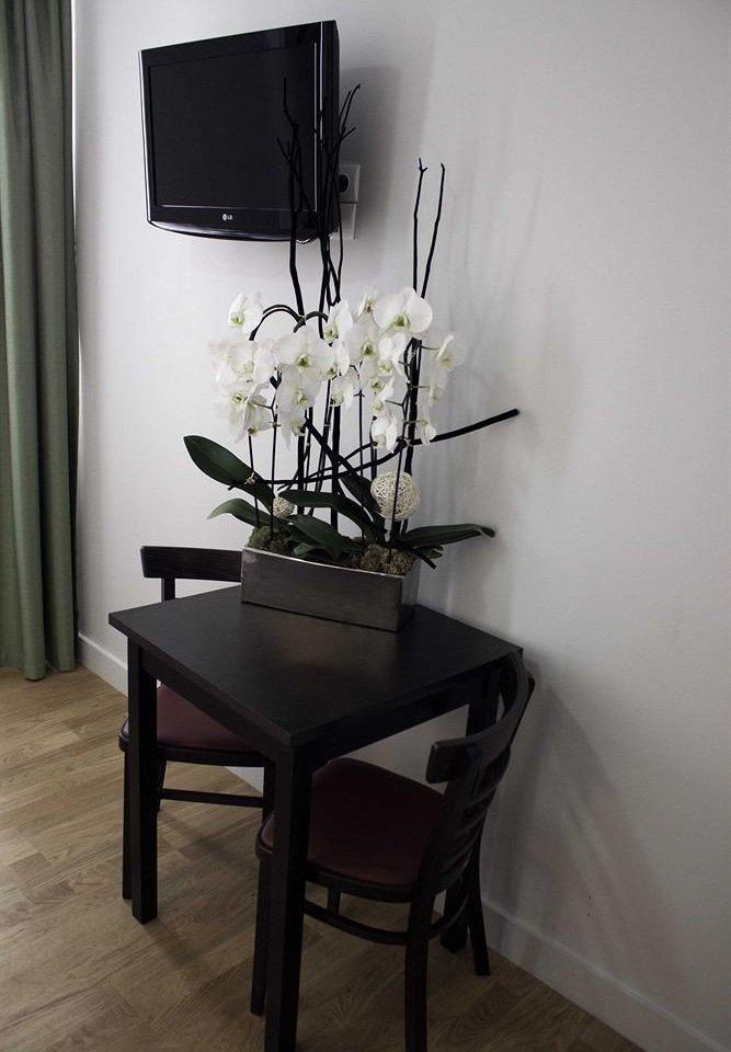 white chair desk living room plant lamp