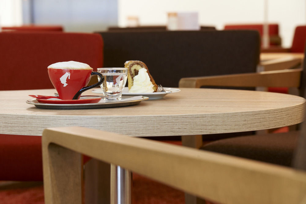 red chair restaurant wooden shape dining table