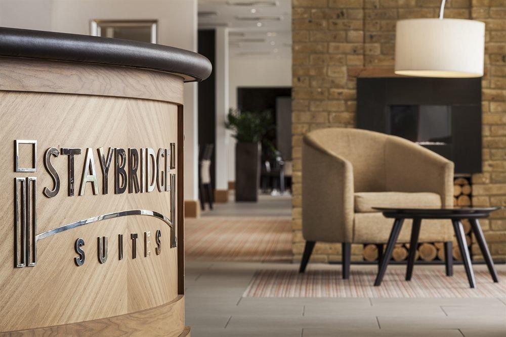 man made object home lighting flooring chair living room