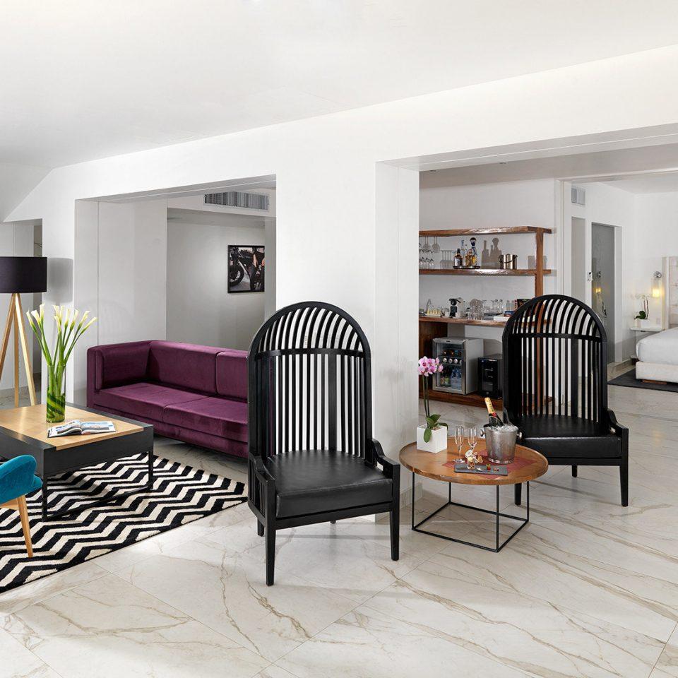 living room chair property flooring interior designer