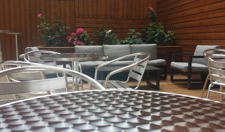 chair property restaurant outdoor structure flooring