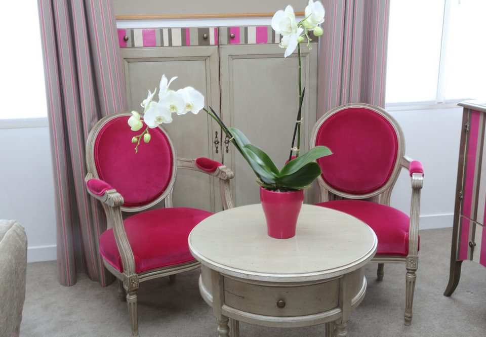 pink chair red product living room