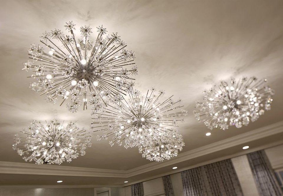 white light fixture light chandelier lighting flower symmetry