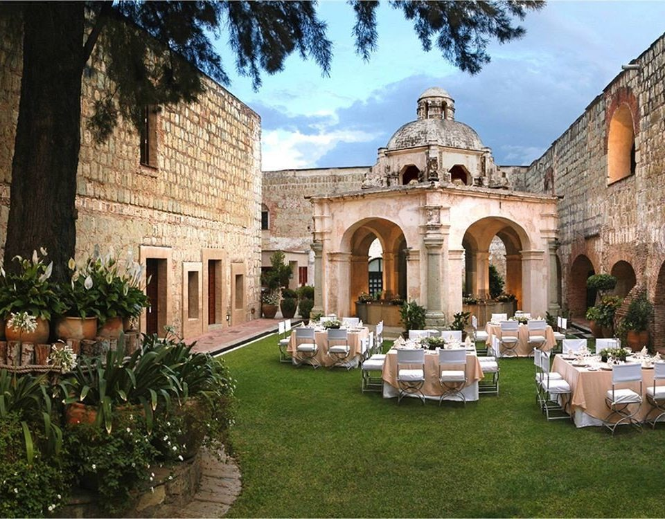 Courtyard Drink Eat Rustic grass building palace old ancient history hacienda mansion place of worship monastery Church chapel stone