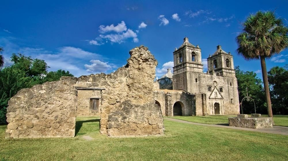 grass stone building rock historic site old Ruins place of worship monastery abbey chapel Church spanish missions in california grassy