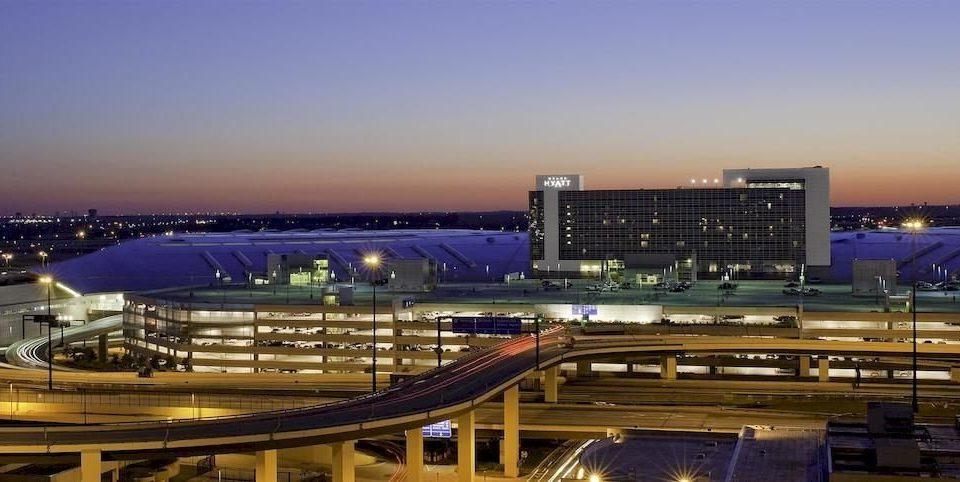 City sky structure building night sport venue stadium evening cityscape convention center arena dusk airport