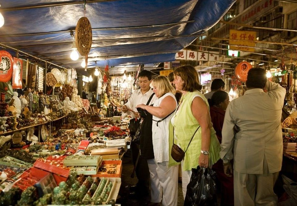 marketplace market City bazaar public space standing vendor retail scene grocery store stall store