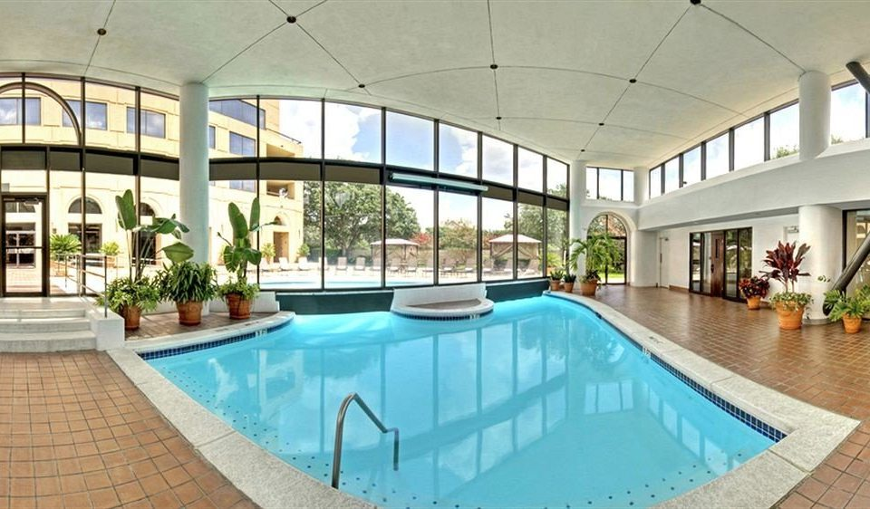 City Classic Pool ground building swimming pool property leisure leisure centre Resort condominium mansion Villa home blue Courtyard backyard tile tiled colonnade