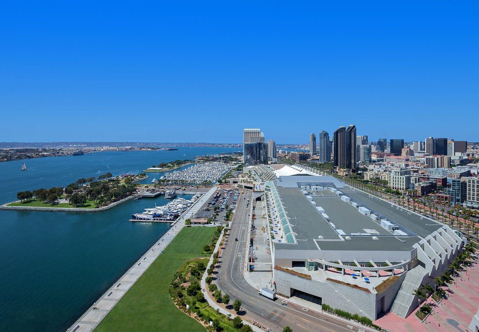 sky water scene marina road way aerial photography bird's eye view Coast dock residential area City walkway cityscape stadium port overlooking highway Island
