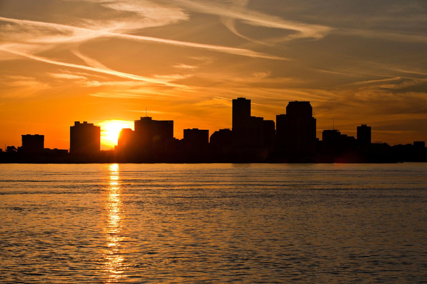 water sky Sunset skyline horizon afterglow sunrise dawn light City Sun dusk Sea morning cloud evening Ocean sunlight Coast cityscape setting distance