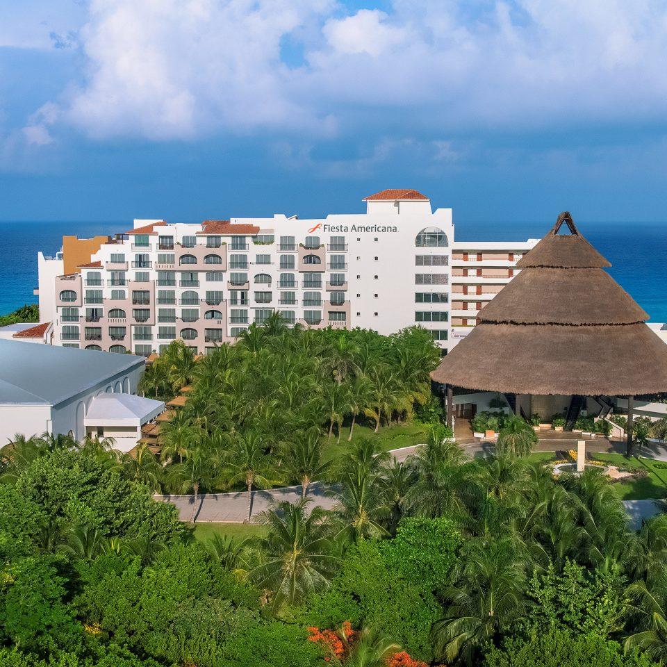 sky Resort Sea palm tree tropics promontory arecales condominium tree City horizon Coast roof