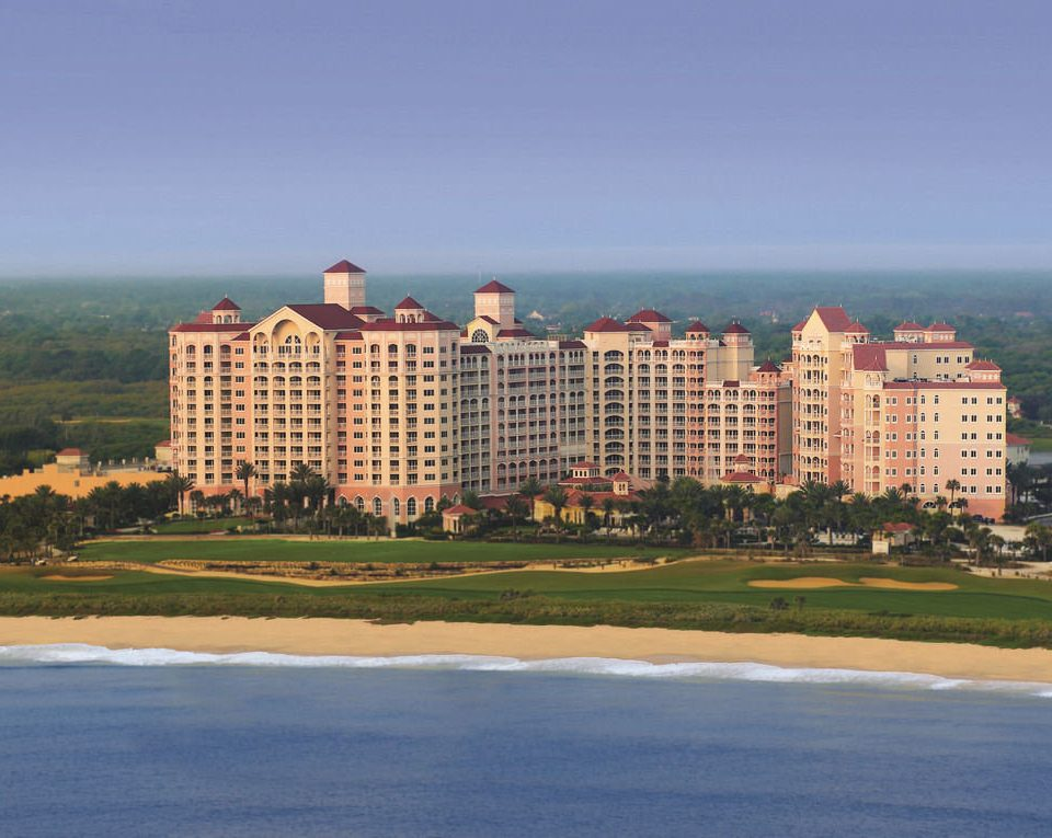 sky grass road horizon landmark Coast residential area skyline City tower block tower Sea panorama shore