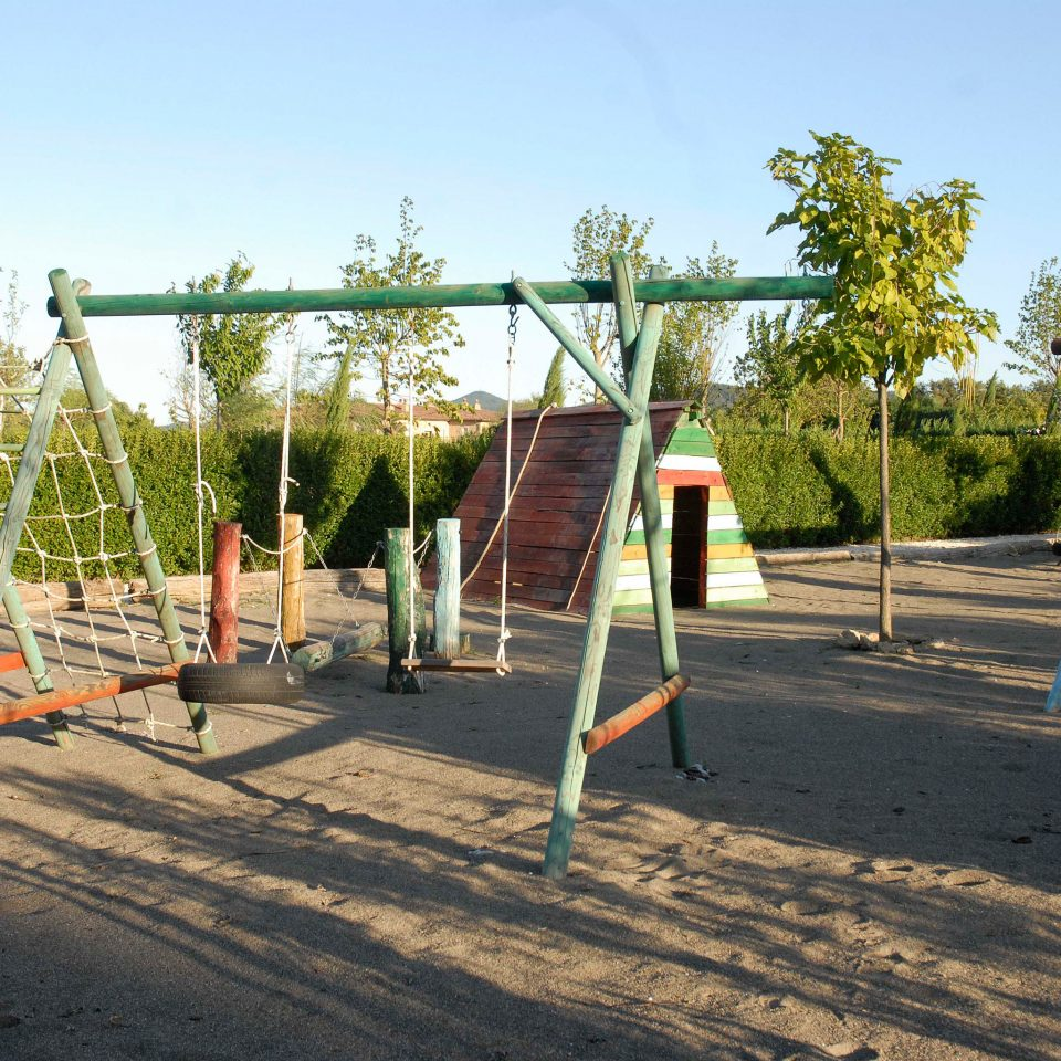 Country Cultural Elegant Family Historic Outdoors Play sky tree ground outdoor play equipment Playground City public space leisure outdoor recreation park recreation swing sandy day