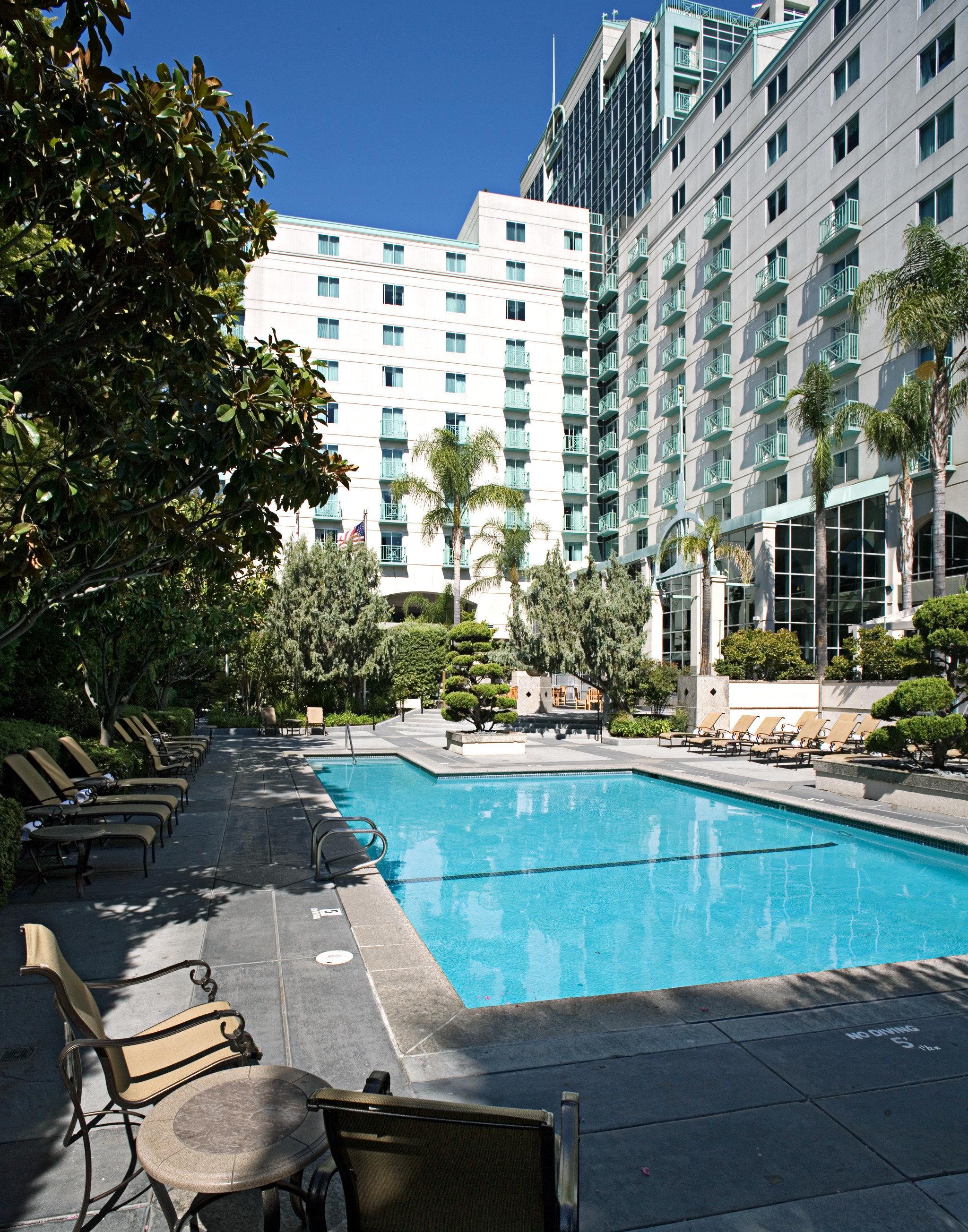 Exterior Lounge Pool tree swimming pool condominium property house park home residential area backyard Courtyard City Resort stone