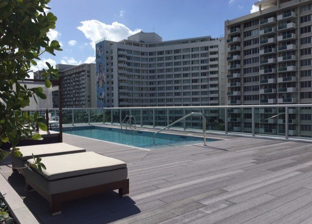 condominium property building swimming pool walkway plaza outdoor structure Deck City