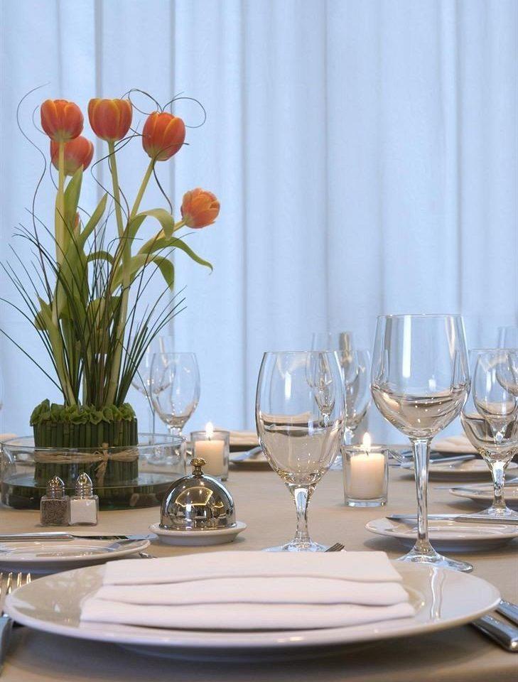 City Dining wine glasses centrepiece curtain restaurant flower floristry lighting glass wine glass