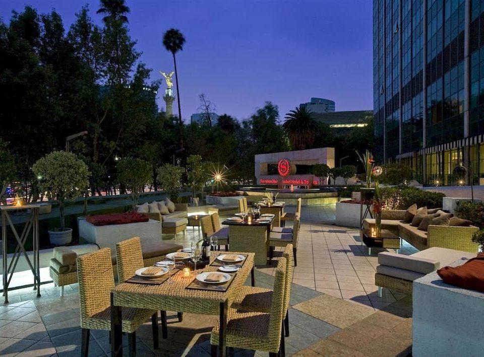 City Dining Drink Eat Patio tree leisure plaza Resort restaurant