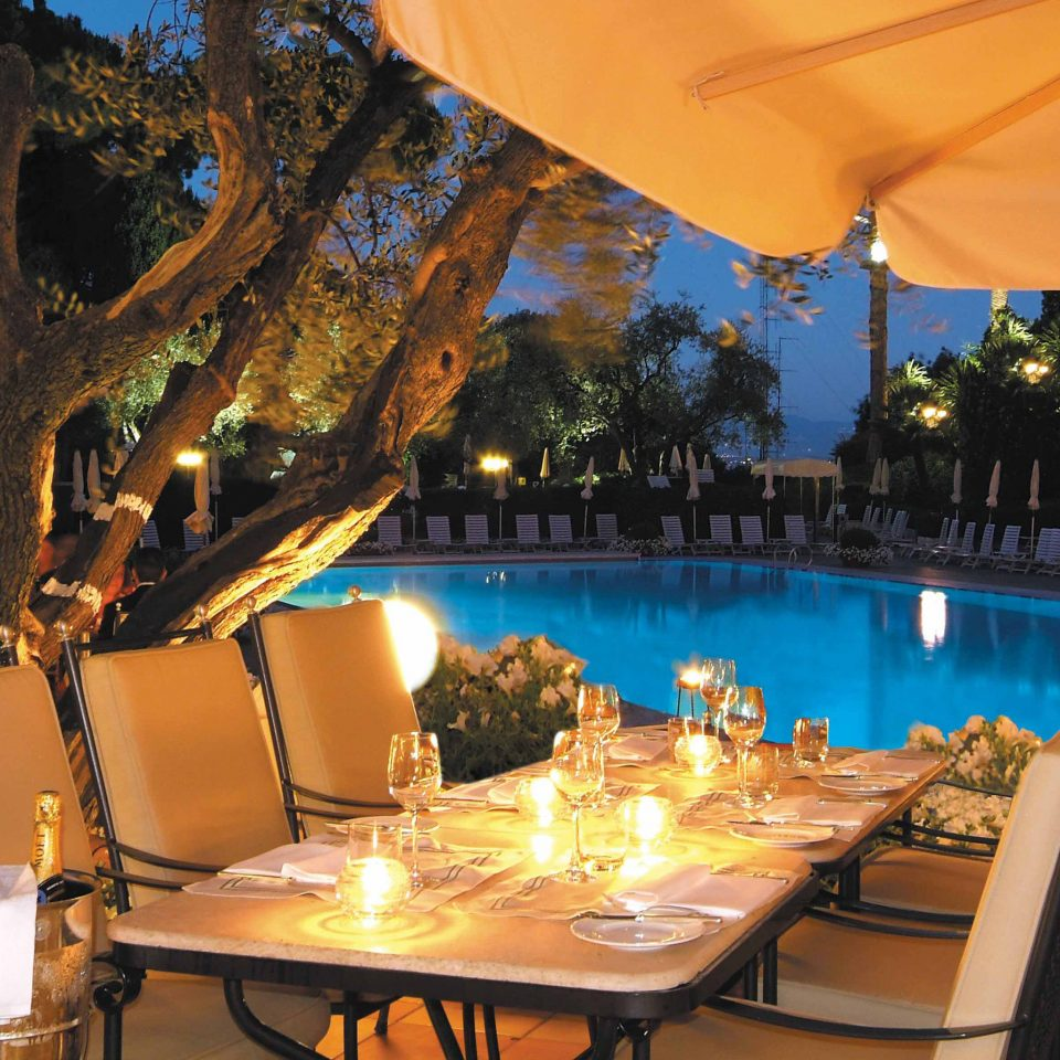 City Dining Drink Eat Elegant Grounds Luxury Pool tree umbrella leisure Resort restaurant