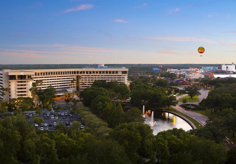 sky tree structure landmark City sport venue atmosphere of earth cityscape stadium Downtown skyline lush hillside