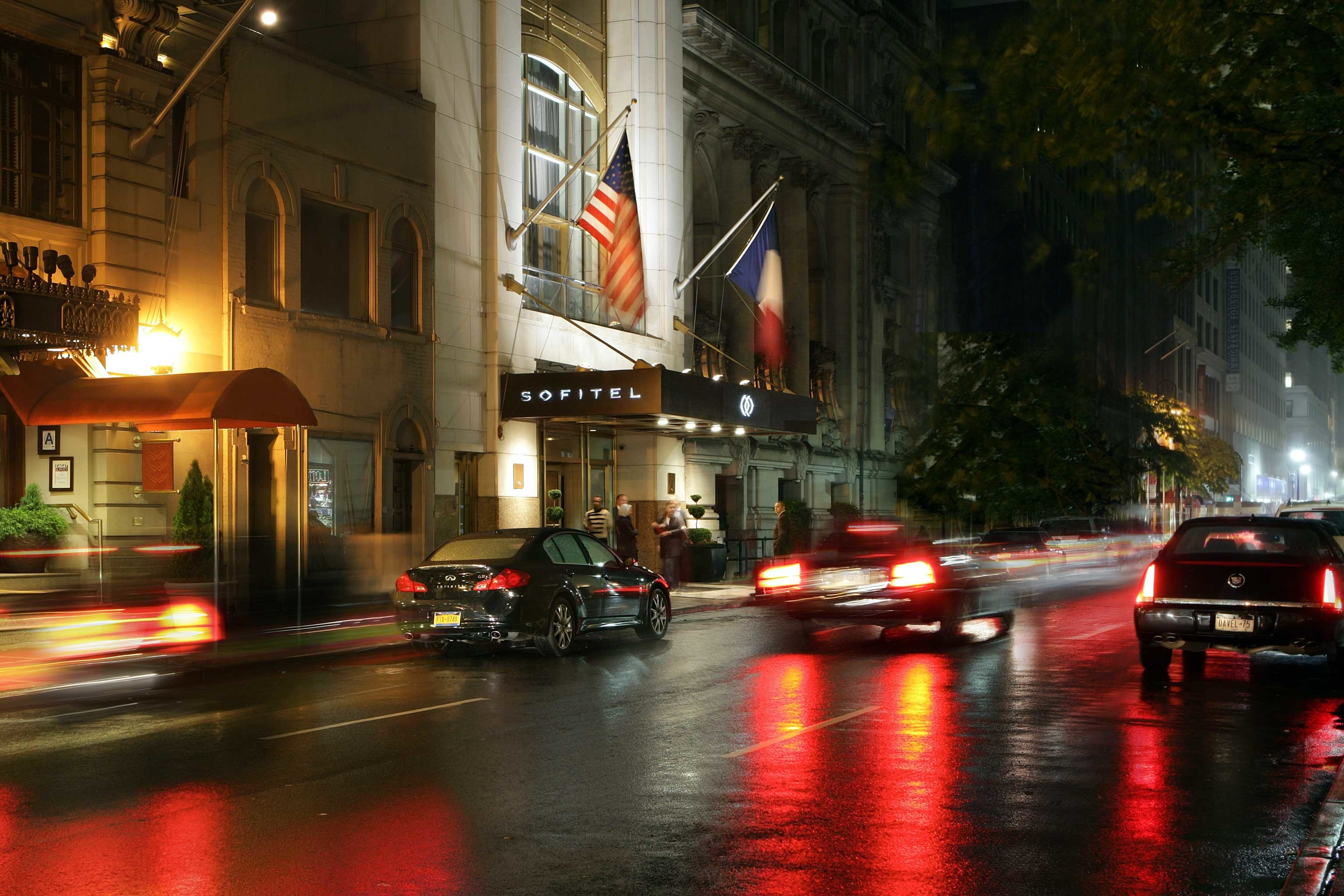 street night road rain traffic light rainy evening darkness cityscape Downtown City wet way blurry