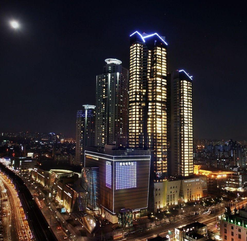 metropolitan area metropolis skyscraper building skyline night cityscape City landmark tower block Downtown evening tower dusk