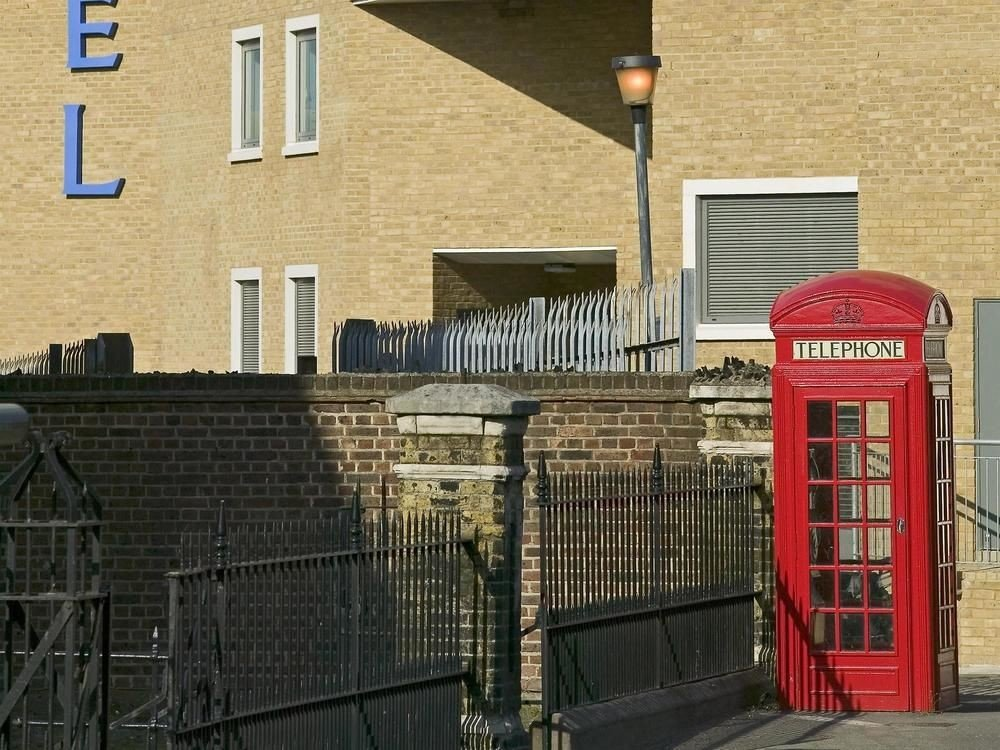 building transport City street Downtown outdoor structure outdoor object telephone booth stone