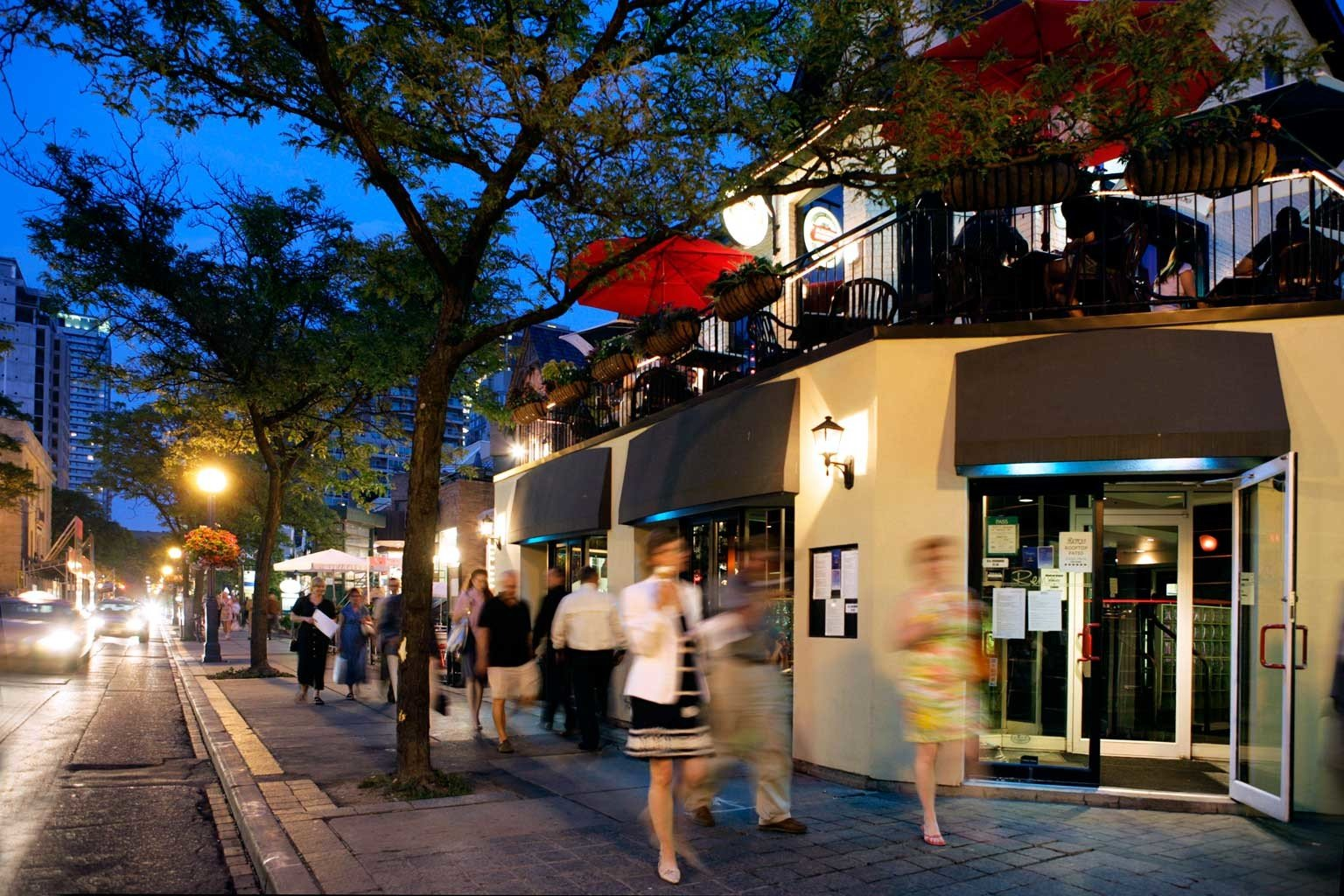 City Exterior Nightlife Shop tree road way crowd street Town scene Downtown sidewalk evening pedestrian shopping