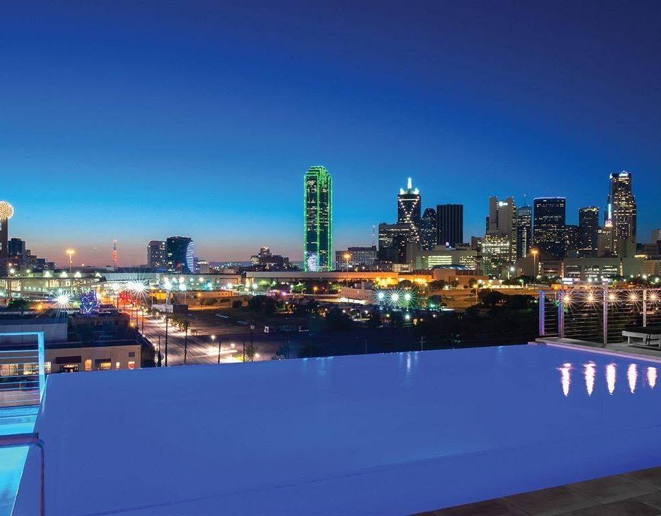City Hip Pool sky metropolitan area skyline horizon cityscape skyscraper night Downtown metropolis dusk