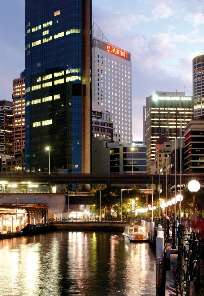 building water metropolitan area City metropolis cityscape landmark skyscraper tower block skyline Downtown night River evening condominium plaza