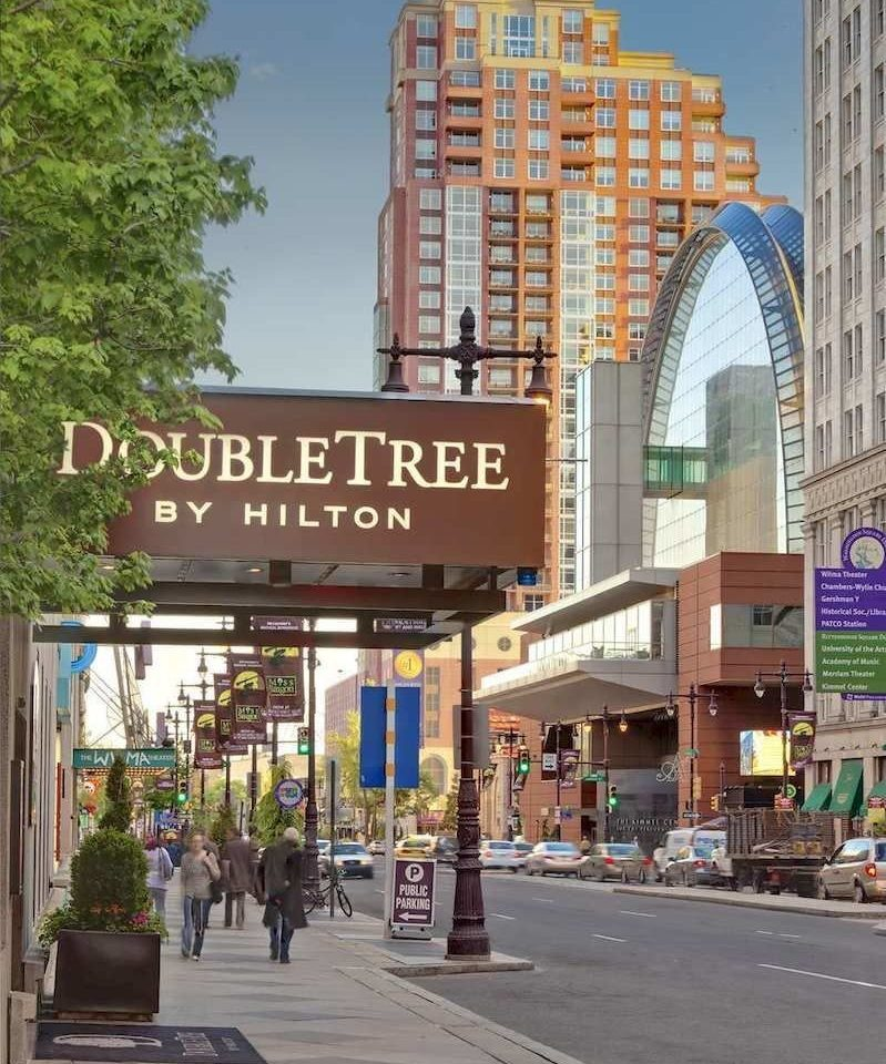 building road City plaza street Town neighbourhood Downtown scene retail shopping mall sign residential area pedestrian condominium shopping public transport outlet store