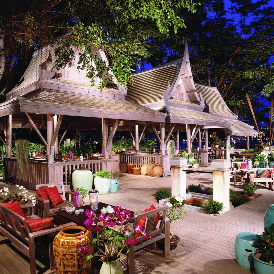 City Drink Eat Hotels Lounge Outdoors Patio Romance Terrace tree building Resort restaurant flower outdoor structure Garden