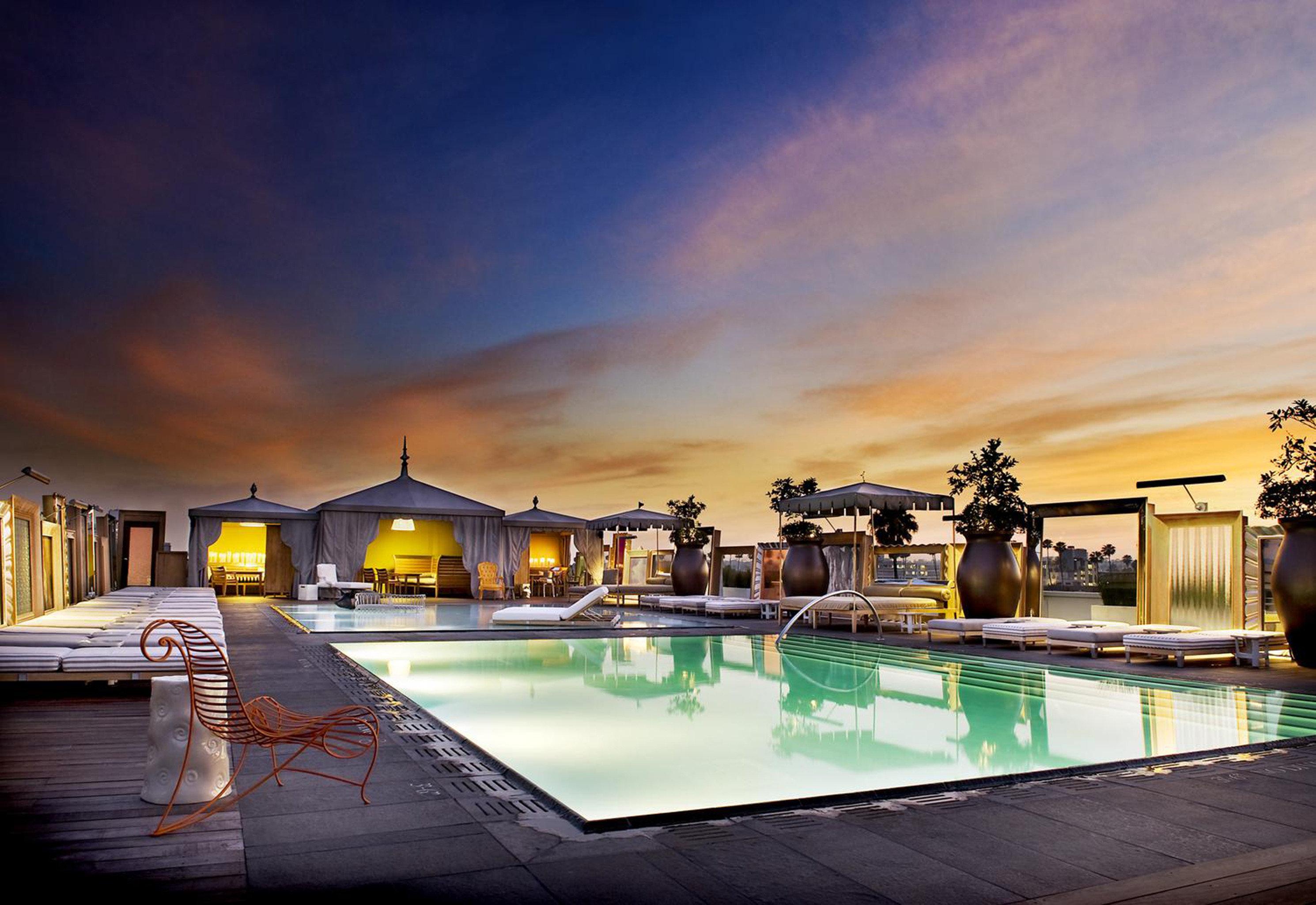City Elegant Modern Outdoors Patio Pool Sunset sky swimming pool night evening Resort dusk cityscape