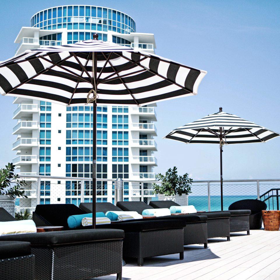 City Exterior Hip Lounge Luxury Modern sky condominium Resort plaza headquarters tower day