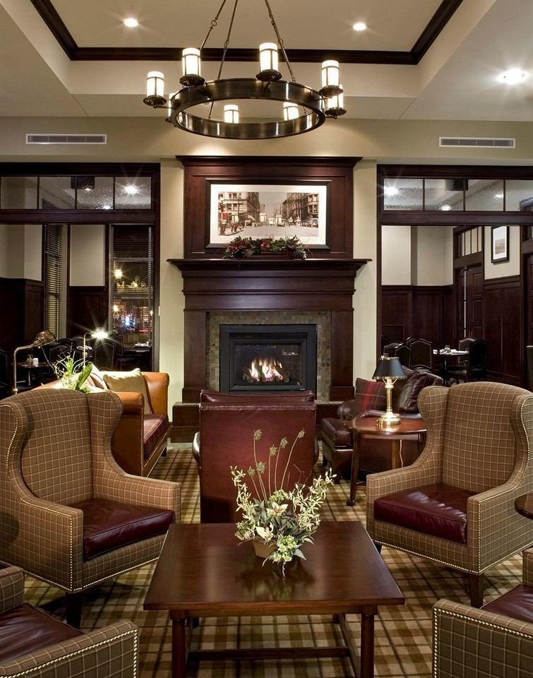 City Family Fireplace Lounge chair Lobby living room property home lighting mansion Suite condominium