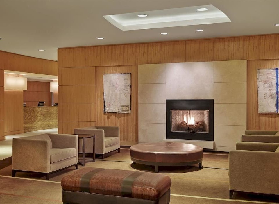 City Fireplace Lobby property living room home cabinetry recreation room lighting Suite Modern