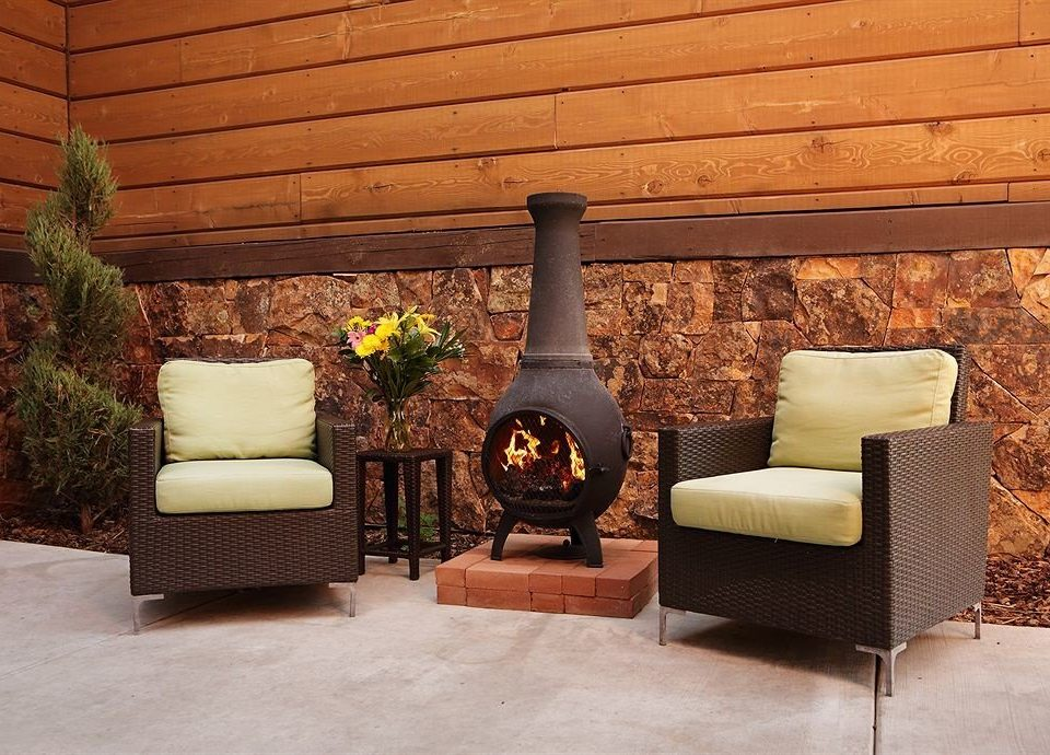 City Fireplace Lodge man made object living room hardwood home lighting wood flooring porch flooring cottage stone